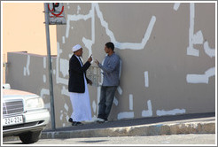 Two men talking. Hout street, Bo-Kaap.