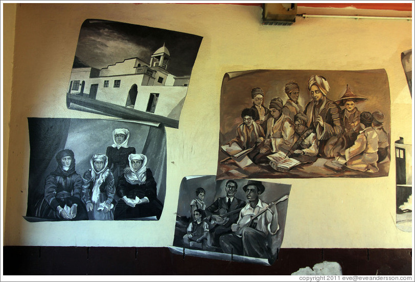 Paintings showing families and professions of early Bo-Kaap residents. Corner of Wale Street and Chiappini Street.