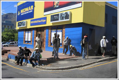 People standing at the corner, looking for work.  Rose Street and Strand Street, Bo-Kaap.