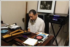 Cape Town jazz musician Hilton Schilder playing piano in his home.