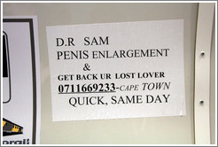 Sign in the commuter train advertising same-day penis enlargement by D.r Sam.