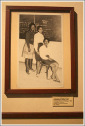 Photography of Nomvuyo, one of the people forcibly removed from her home and relocated to a township.  District Six Museum.