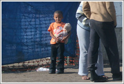 Child with doll.  Langa township.