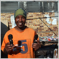 Kip, an excellent artist, with his wares.  Langa township.