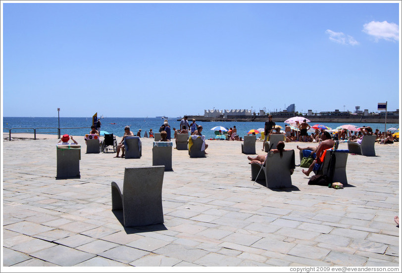 barcelona beach photos. Stone each chairs between