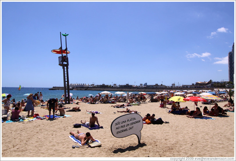 "Sign that  says ""Sóc una platja, no pas un cendrer enorme, ok?"" (""I'm a beach, not a huge ashtray, ok?"").  Nova Icària beach."