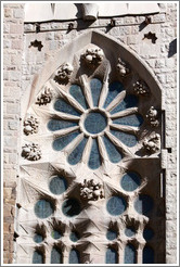 Window with fruit-like figures around it.  La Sagrada Fam?a.