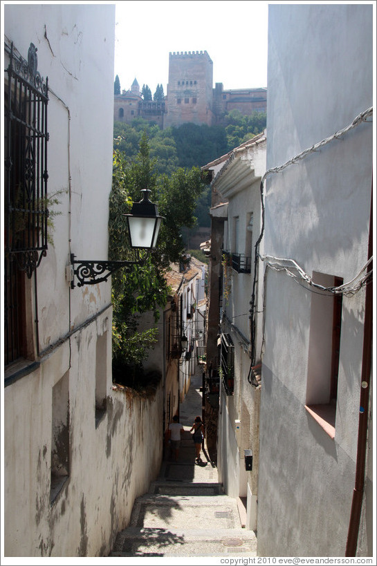 Calle del Candil, Albaic? with the Alhambra in the background.