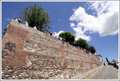 People sitting on the wall.  Mirador de San Nicol?  Albaic?