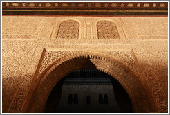 Arch leading to Patio del Cuarto Dorado, Nasrid Palace, Alhambra at night.