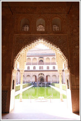 Patio de los Arrayanes seen through an arch in the Sala de la Barca, Nasrid Palace, Alhambra.