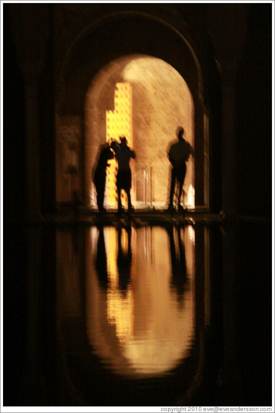 Reflected silhouettes, Patio de los Arrayanes, Nasrid Palace, Alhambra at night.