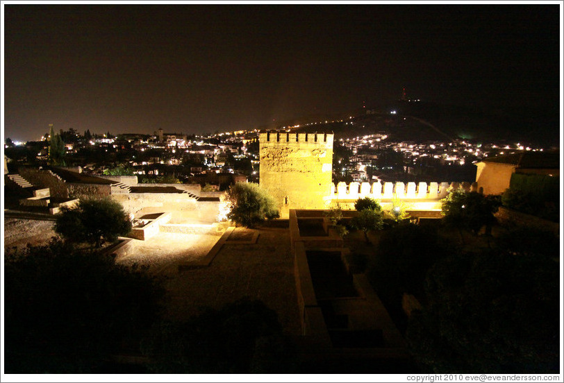 Patio de Muchaca, Alhambra, and with a view of the city of Granada at night.