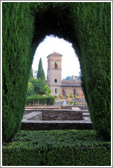Parador de San Francisco through a hole in the hedge, Alhambra.