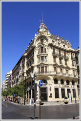 Building at the corner of Calle Reyes Cat?os and Gran V?de Col?city center.