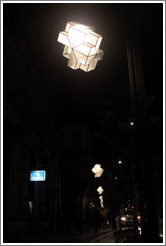 Row of street lights at night.  Calle Gran V?de Col? City center.