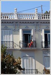 Woman in a red dress on a balcony. Plaza de Bib-Rambla, city center.