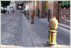 Colorful pomegranate bollards, Plaza de San Agust? city center.