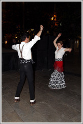 Man and woman dancing flamenco on the street at night during the Fiesta de las Cruces.  Plaza del Carmen.  City center.