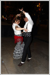 Woman and man dancing flamenco on the street at night during the Fiesta de las Cruces.  Plaza del Carmen.  City center.