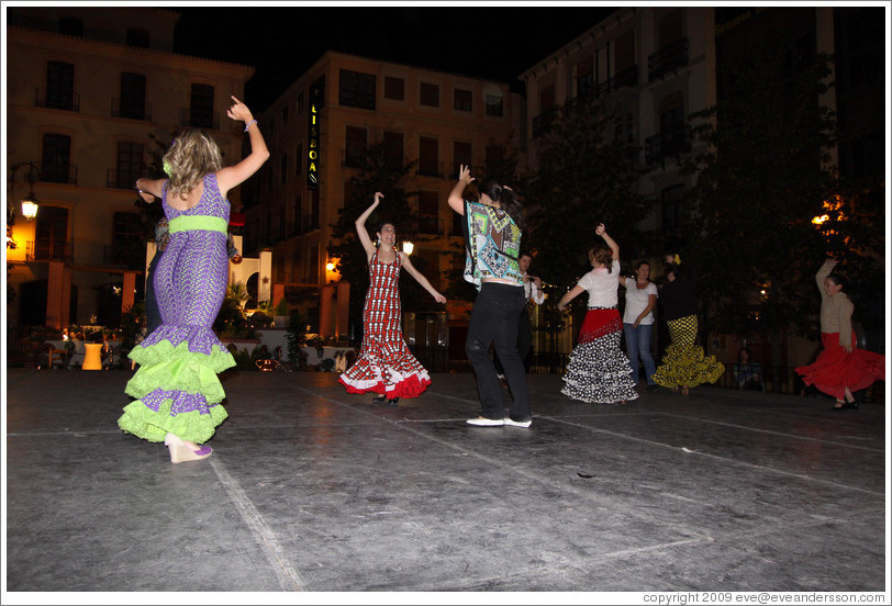 People dancing flamenco on the street at night during the Fiesta de las Cruces.  Plaza del Carmen.  City center.