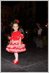 Girl in red.  Fiesta de las Cruces.  Plaza del Carmen.  City center.