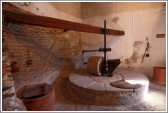 Olive crusher powered by water. 15th century Moorish olive oil mill, used by the town of Nig?elas until 1920.