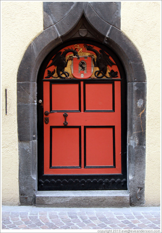 Door with dragons tying a ribbon, Rathaus, Old Town, Chur.