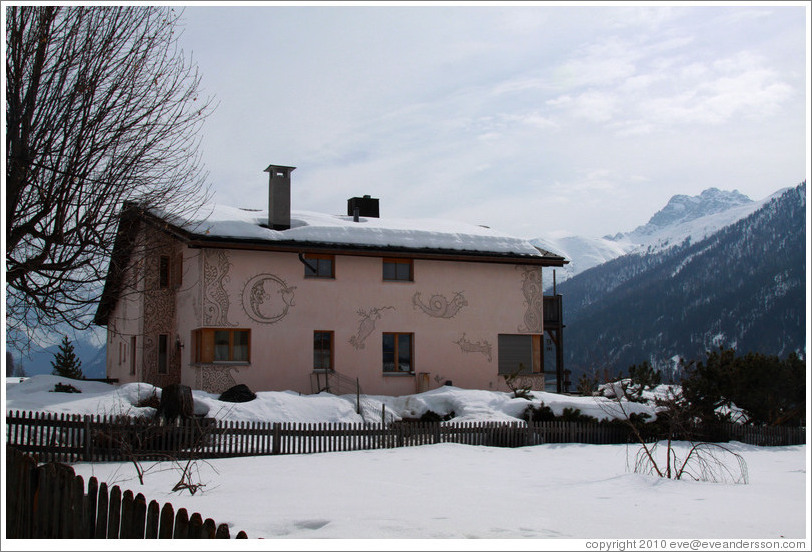 Romansh building, with mountains behind.
