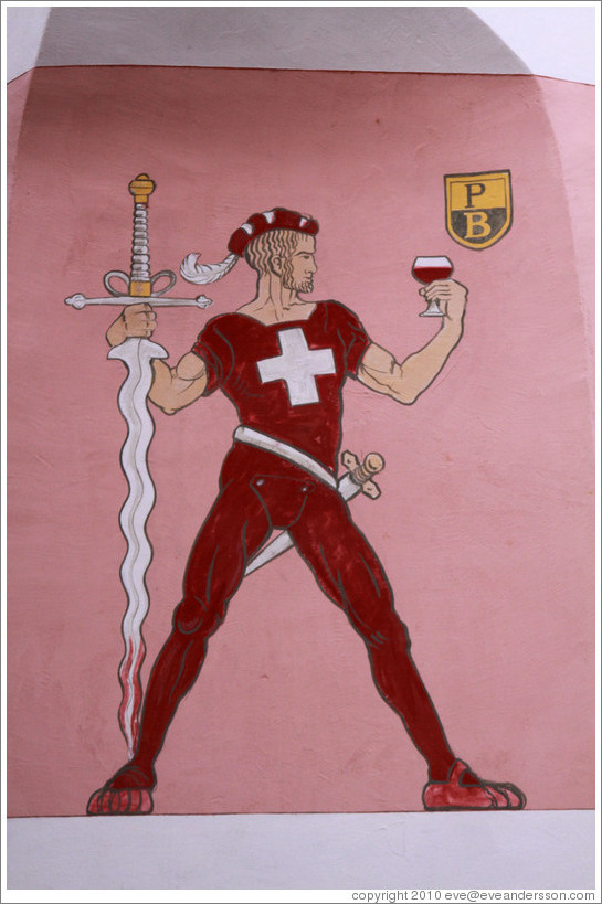 Swiss man with swords and a glass of wine, painted on the side of a building.