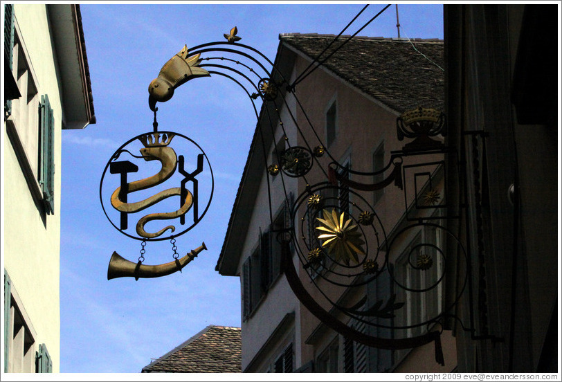 Shop sign with snake wearing crown.  Altstadt (Old Town).
