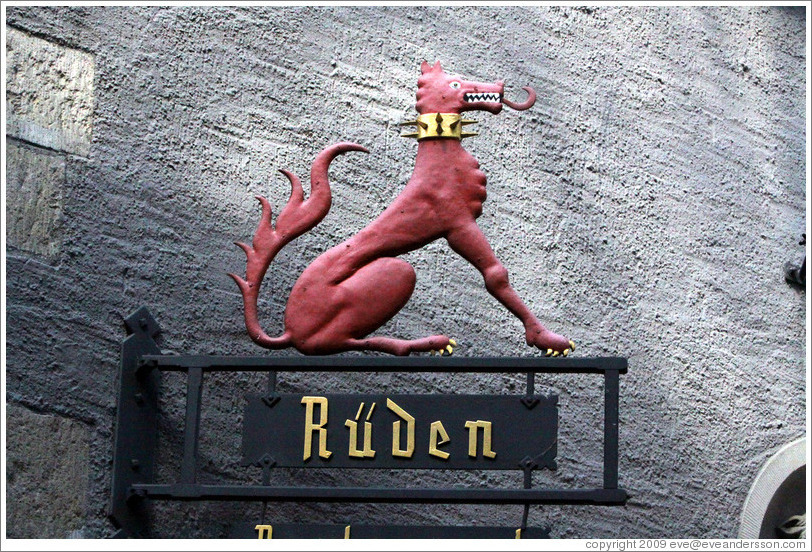 Dragon-dog with spiky collar. R?den Restaurant. Altstadt (Old Town).