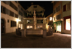 Fountain on Spiegelgasse at night.  Altstadt (Old Town).
