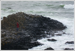 Eve, standing on Giant's Causeway (the only person remaining after a sudden downpour).