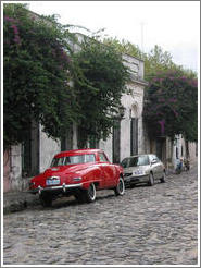 Cobblestone street with old car.