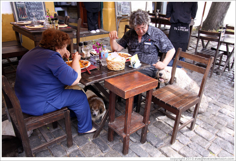 People at a restaurant, with dogs. Calle de Santa Rita, Barrio Hist?o (Old Town).