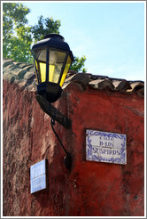 Streetlamp and sign for Calle de los Suspiros (Street of the Sighs).