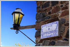 Streetlamp and sign for Calle de San Pedro (Street of St Peter).