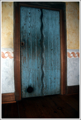 Door containing cat door.  Guadalupe Chapel.  San Juan Bautista Mission.