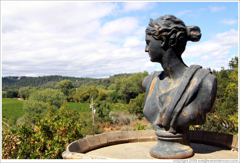 Female bust overlooking a vineyard, Bella Vineyards.