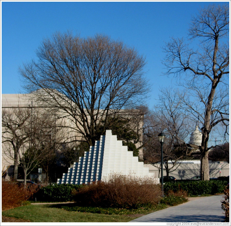 White pyramid at the National Sculpture Garden.  Capitol Building in background.