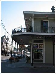 Garden district.  Magazine street.  Bar with balcony.