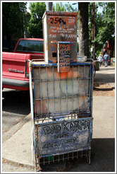 Newspaper vending machine with Bad Karma graffiti.  Hoyt St. and 23rd Ave.  Alphabet District.
