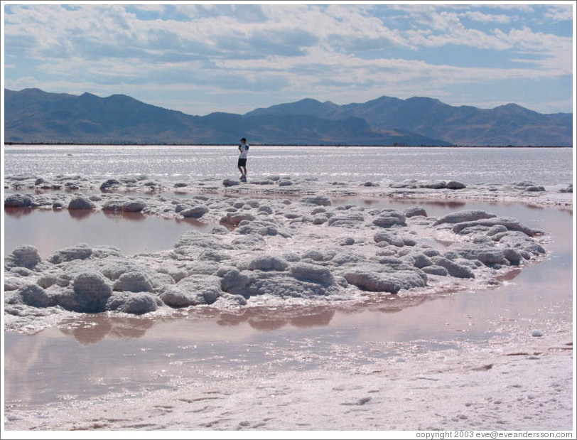 Man walking on Spiral Jetty in the Great Salt Lake.