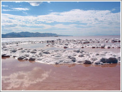 Pink water with white salt crystals, near the Spiral Jetty.  Reflections of clouds.