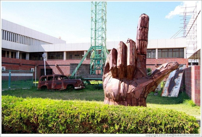 Sculpture depicting a hand pointing upward, the MMD party symbol, outside the Lusaka National Museum.